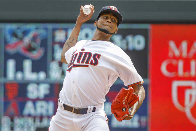 Minnesota Twins starting pitcher Ervin Santana throws to the Kansas City Royals in the first inning of a baseball game Sunday, Aug. 5, 2018, in Minneapolis. (AP Photo/Bruce Kluckhohn)