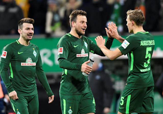 Soccer Football - Bundesliga - Werder Bremen vs Hamburger SV - Weser-Stadion, Bremen, Germany - February 24, 2018 Werder Bremen's Ludwig Augustinsson celebrates with Philipp Bargfrede at the end of the match REUTERS/Fabian Bimmer DFL RULES TO LIMIT THE ONLINE USAGE DURING MATCH TIME TO 15 PICTURES PER GAME. IMAGE SEQUENCES TO SIMULATE VIDEO IS NOT ALLOWED AT ANY TIME. FOR FURTHER QUERIES PLEASE CONTACT DFL DIRECTLY AT + 49 69 650050