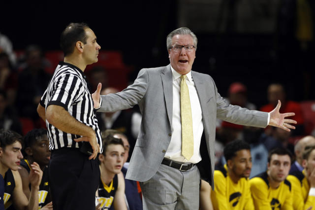 FILE - In this Jan. 7, 2018, file photo, Iowa coach Fran McCaffery, right, speaks with an official during the first half of the team's NCAA college basketball game against Maryland in College Park, Md. McCaffery was suspended for two games for a profanity-laced tirade directed toward the refs last month. He has a history: Both he and his wife were ejected from a game in 2006 for swearing at the officials. (AP Photo/Patrick Semansky, File)