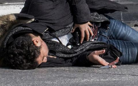 Pictures from the scene show Aqal with a knife and what appears to be a suicide belt