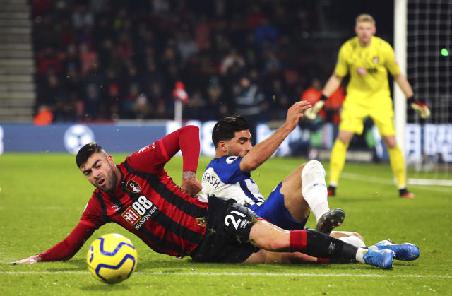 Bournemouth's Diego Rico, left, and Brighton and Hove Albion's Alireza Jahanbakhsh clash during their English Premier League soccer match at the Vitality Stadium in Bournemouth, England, Tuesday Jan. 21, 2020. (Mark Kerton/PA via AP)