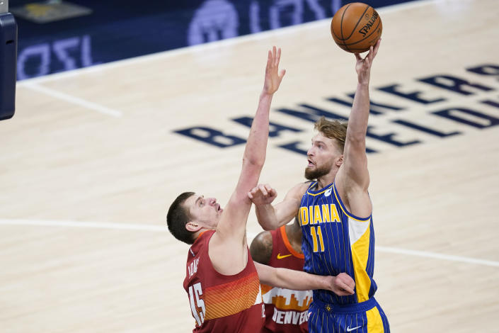 Indiana Pacers' Domantas Sabonis (11) shoots over Denver Nuggets' Nikola Jokic (15) during the first half of an NBA basketball game, Thursday, March 4, 2021, in Indianapolis. (AP Photo/Darron Cummings)