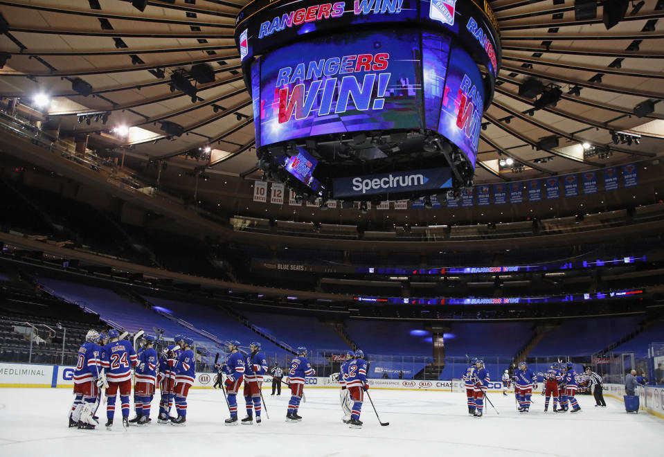 The New York Rangers celebrate a win over the New York Islanders in an NHL hockey game Saturday, Jan. 16, 2021, in New York. (Bruce Bennett/Pool Photo via AP)
