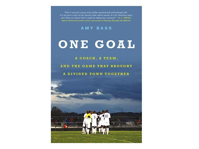 "<p>ONE GOAL<em> tells the inspiring story of a city and its high school soccer team—the Blue Devils of Lewiston, Maine—and how their quest for a state championship title united a city that had undergone dramatic change after thousands of Somali refugees resettled there. </em></p><p><em>Lewiston is an economically struggling, overwhelmingly white, Catholic, mill town in one of the whitest states in America, and racial tensions hit a fever pitch as longtime residents and newcomers were uneasy living side by side with their new neighbors. They spoke a different language and practiced a different religion, and matters weren't helped when the mayor asked Somalis to stop coming. Lewiston's long history with French-Canadian immigrant factory workers did nothing to dispel myths about the Somalis, despite the constant reiterations of reality from city officials, community leaders, and teachers like Ronda Fournier and high school soccer coach Mike McGraw. But McGraw, who had come close to a state title back in 1991, began to see how newcomers like Shobow Saban could help lead the way, and integrated the refugee kids onto his team. If he could put the rules of the game to work for his increasingly diverse team, perhaps the community would follow in their footsteps, and perhaps their shared passion for soccer would help heal old wounds. </em></p><p><em>The following is adapted from <a href=""https://www.amazon.com/gp/product/0316396540/ref=as_li_qf_asin_il_tl?ie=UTF8&creative=9325&linkCode=as2&creativeASIN=0316396540&linkId=0de3868df685ef161049ca52b6b971f9&tag=sisocceronegoalbook0223-20"" rel=""nofollow noopener"" target=""_blank"" data-ylk=""slk:One Goal: A Coach, a Team, and the Game That Brought a Divided Town Together"" class=""link rapid-noclick-resp"">One Goal: A Coach, a Team, and the Game That Brought a Divided Town Together</a> by Amy Bass, published by Hachette Books. Copyright © Amy Bass 2018.</em></p><p>Soccer lends itself to a particular kind of teamwork. It is a game of continuity, with more flow than ruptures. It doesn't reorganize after a whistle, like basketball, or have a to-do list like the innings of a baseball game. To score in soccer, a team has to move the ball through an enormous amount of space, making decisions about who will take it where, from the first touch until someone sends it hurtling toward the net. Just by doing what a soccer team was supposed to do, the Blue Devils could become an example to the community.</p><p>Ronda Fournier, an assistant principal at Montello, often heard McGraw talk about ""the ball"" as she watched him adapt to change. An unapologetic ""girl from the backwoods,"" Fournier grew up in Sabattus, a small town just a stone's throw from Lewiston, and attended Oak Hill High School, where football reigns supreme. A three-sport athlete herself—field hockey, basketball, and softball—she studied education at the University of New England and eventually landed in the biology classroom next to McGraw.</p><p>""He's a really special man,"" she says, smiling, a heavy Maine accent soaking every word. ""You know? We are all blessed to have him as a part of our lives.""</p><p>Over the years, she got to know a lot of soccer players. If McGraw stepped out for a moment, they knocked on her door instead.</p><p>""Mrs. Fournier, you gonna let us in so we can put away our soccer gear?"" they'd ask. ""Yep, no problem,"" she'd answer. ""I'll put it in for ya.""</p><p>Over the course of ten years, she and the coach developed a close working relationship. Few people had a better view to see how McGraw developed his winning formula.</p><p>""I remember him telling me of how difficult it was in the beginning, but it was all about the soccer.""</p><p>By prioritizing the game, she says, McGraw could make sure ""the other stuff just didn't interfere."" They didn't have to have conversations about where a player was from, or what religion he practiced, or what language he spoke, or what his family had been through. Instead, they could focus on what a kid could do on the pitch.</p><p>McGraw, the players still joke, doesn't care where they're from as long as they pass the ball. ""I watched Mike in the classroom for years. I see him out on the coaching field, and he does the same thing,"" says Fournier. ""He takes a kid's strength, and he helps that kid use their strengths to overcome their weaknesses. He shows how they're related, so that a kid can capitalize.""</p><p>Fournier pauses. ""Any kid,"" she says, and then waits another moment before repeating it, with emphasis. ""Any. Kid.""</p><p>Fournier knows well the challenges of teaching here, but she doesn't see the Somali influx as anything other than Lewiston being Lewiston. The newest immigrants have needs, just like those who came before them, and it is the schools' job to meet them.</p><p>""It started with the French-Canadians, right?"" she says.</p><p>Her own grandmother came from Canada, her grandfather from Scotland. They worked full-time shifts at the Rubber Heel, a long-gone shoe manufacturing plant in Sabattus, while growing cucumbers for the Litchfield pickle plant as a side job.</p><p>""You know, Lewiston's gonna be kind of rough,"" she remembers people saying when she first considered the job in 2005. ""Things are going to be different—you sure you want to go teach there?""</p><p>""I don't know about you, but I don't think it matters where the kids come from,"" she told them, shrugging off the comments. ""They all need the same thing.""</p><p>She knew what people were too polite to come right out and say. Lewiston kids, among the poorest in the state, were considered problematic well before the Somalis came. But now, according to rumors, things were worse. Kids praying in the hallway, speaking different languages, dressing in ""weird"" clothes, eating ""strange"" foods. But Fournier didn't care what anyone thought they knew about Lewiston High School. Teaching was teaching.</p><p>""To me, it didn't matter at all,"" she says. ""Kids need love, they all need to know that somebody cared about them. And now they all want to play soccer.""</p><p>Fournier relied on McGraw for advice to help his players in her classes. He used the same strategies in the classroom he did on the field, emphasizing teamwork, urging her to call on a struggling student's classmates to help. There was no question McGraw knew what was best for the players, academically, on the field, or just walking down the hallway.</p><p>But McGraw, too, faced challenges. Names no longer rolled off his tongue, and at times he resorted to calling players by their numbers until he became more familiar with pronunciations. The high school yearbook showed just how rapidly surnames in Lewiston were changing; the ""A"" section of class photos grew quickly because of Somali surnames. In the early days, aside from class photos, the soccer pages were the only place Somali students appeared. They weren't photographed at prom. There were no casual photographs of them hanging in hallways or jumping around during Spirit Week. No one paid to put their baby picture in the back pages because such photos didn't exist; if they did, there was no money for such things.</p><p>But on the soccer field, Somali students started to lay claim, quickly becoming the majority of the varsity roster. As McGraw strategized his so-called advantage of the ball to integrate the team, he also helped incorporate the new students into the culture of the high school. He didn't think twice about it—the game came first, and trust worked both ways. He knew that when those first Somali students came to talk to him about playing, some level of trust was established. But he had to make it grow.</p><p>McGraw knew that whatever happened on the field— teamwork, communication, patience, and persistence—could impact the community as a whole. But it was going to take some serious coaching, and not just in terms of scoring goals. There'd been animosity and growing pains—all of his players had stories. Hallway skirmishes. Standoffs in the cafeteria. ""Go Back to Africa,"" among other things, scrawled on bathroom walls or in the dirt on car windows. White kids telling Somali kids that they paid for their shoes, their food, and their apartments. Fights in the parking lot. Teachers who showed Black Hawk Down in class or reminded students that their behavior wasn't acceptable ""in this country."" McGraw knew he had to do more than yell ""together"" from the sideline. Moving together, winning together wasn't going to solve the world's problems. But it was a first step. What, he wondered, was the next step?</p><p>Shobow remembers it well. It happened on a hot day in the early fall of his freshman year. McGraw saw the players getting ready as he approached the practice field. He watched them pulling up their long socks, strapping on shin guards, and huddled over cleats, trying to get knots out of tangled laces. They weren't together, he realized, and there was a pattern. The Somali kids, Shobow included, sat in the shade by the garage, leaning against the cool bricks. The white kids were over in the sun, sitting around the light pole. Both groups were talking, separately. Both groups were getting ready, separately.</p><p>This, McGraw thought, has to change. It has to change right now. As the coach, he had to change it. He had no doubt he could succeed at making this better; this was one of his strengths. Soccer was the connector. He had to make them see that.</p><p>""I want you guys to come over here in the middle and sit,"" he called as he walked over. They looked up, unsure of what he meant. He started pointing, moving players around, making sure they mixed up. Ali here, Jonny there.</p><p>""You!"" McGraw roared, pointing at Shobow. His voice had yet to descend into its usual midseason rasp. ""Come here—sit.""</p><p>Shobow hopped up almost instantly, not just because coach just told him to, but also because he realized what McGraw was trying to do. He wanted to bring them together. He wanted to help them be together. This, thought Shobow, was good.</p><p>McGraw continued to point, calling each of them out, until he was satisfied with the reconfiguration. Now they are speckled, he thought. Perfect. It was time to take an old-school idea of team and apply it to these players who sat before him. He wasn't trying to save the world; he wanted to win. And to do that, he needed to build relationships, something he was good at. On the field, at least, he needed them to shed their identities—white, black, Muslim, Catholic, Franco, Somali, native, immigrant—and become something new: a team.</p><p>""Okay, this is how it's gonna be,"" McGraw started. ""It has to be this way—this is how a team plays. This is how I want you to be on the field and off the field: together.""</p><p>The players looked at one another and began to relax. Almost immediately, McGraw noticed a change in their demeanors, their bodies, their faces.</p><p>""To play the game, you're gonna have to play together. It's the only way to play,"" he continued.</p><p>He noticed some of them starting to smile. He was on to something. Keep going, he thought. Take it all the way.</p><p>""You're going to have to talk to each other, because it's the only way we're gonna win,"" he continued. ""Sometimes our communities don't understand each other, but you can show the adults how it is supposed to be. By playing together, that'll send a message that our cultures can get along.""</p><p>But he knew it was going to take more than suiting up together. Learning how to be teammates, if not friends, was a process on and off the field.</p><p>""This is how I want you to look everywhere you go,"" McGraw continued. ""Everywhere. If you're going to the store, if you're going to class, you guys have to do it together. High-fives in the hallway. You need to hang out together. You don't have to sit together in the cafeteria if you don't want to, but you need to stick up for each other and be together. It's a brotherhood.""</p><p>Wow, thought Shobow, stretching out his thin legs. From his new location on the grass, the sun on his back, he liked what he was hearing. He wanted his team to be united. A new sense of team spirit came across him, a deeper sense of connection. It was encouraging to hear Coach talk about this, to see him face it headon. Shobow knew from his friendship with Jonny how important this was.</p><p>McGraw finished his speech. It was time for practice. The players got up and started walking onto the field to warm up.</p><p>""Good job, Coach,"" Shobow said to McGraw in a low voice as he walked past him, keeping his eyes down out of respect. ""That was good.""</p><p>McGraw smiled, satisfied. For the next decade, it would be almost impossible to talk about Blue Devils soccer without referring to the day McGraw created his so-called speckled team, his constant sideline cry of ""Together! Together!"" taking on new meaning.</p><p>""How would you guys say it?"" he asked a few Somalis on the team one day. ""How would you say 'together'?""</p><p><em>Pamoja ndugu, </em>a few replied. It was Swahili, one of the many languages of the refugee camps. It meant ""together brothers.""</p><p>It became their rallying cry. ""One, two, three!"" they shouted before every game, huddled together, hands in the middle, McGraw at the center. <em>""PAMOJA NDUGU!""</em></p>"