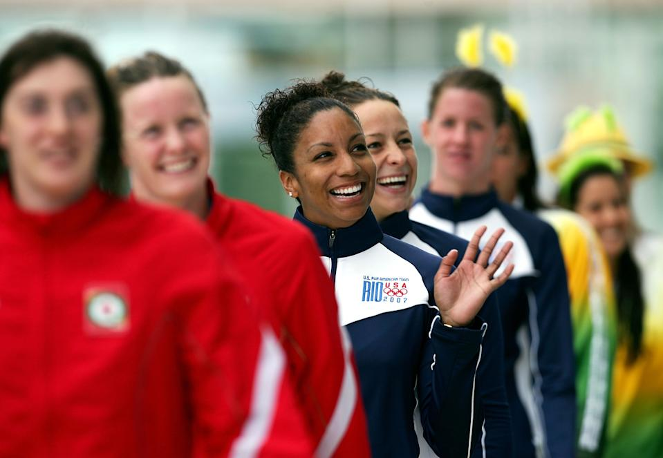 Maritza Correia of the United States of America smiles with her team after they received their gold medals in the 4x100m Freetstyle at the 2007 XV Pan American Games at the Maracana Stadium on July 19, 2007.