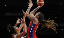United States' Brittney Griner (15), right, shoots over Nigeria's Pallas Kunaiyi-Akpanah (3) during women's basketball preliminary round game at the 2020 Summer Olympics, Tuesday, July 27, 2021, in Saitama, Japan. (AP Photo/Charlie Neibergall)