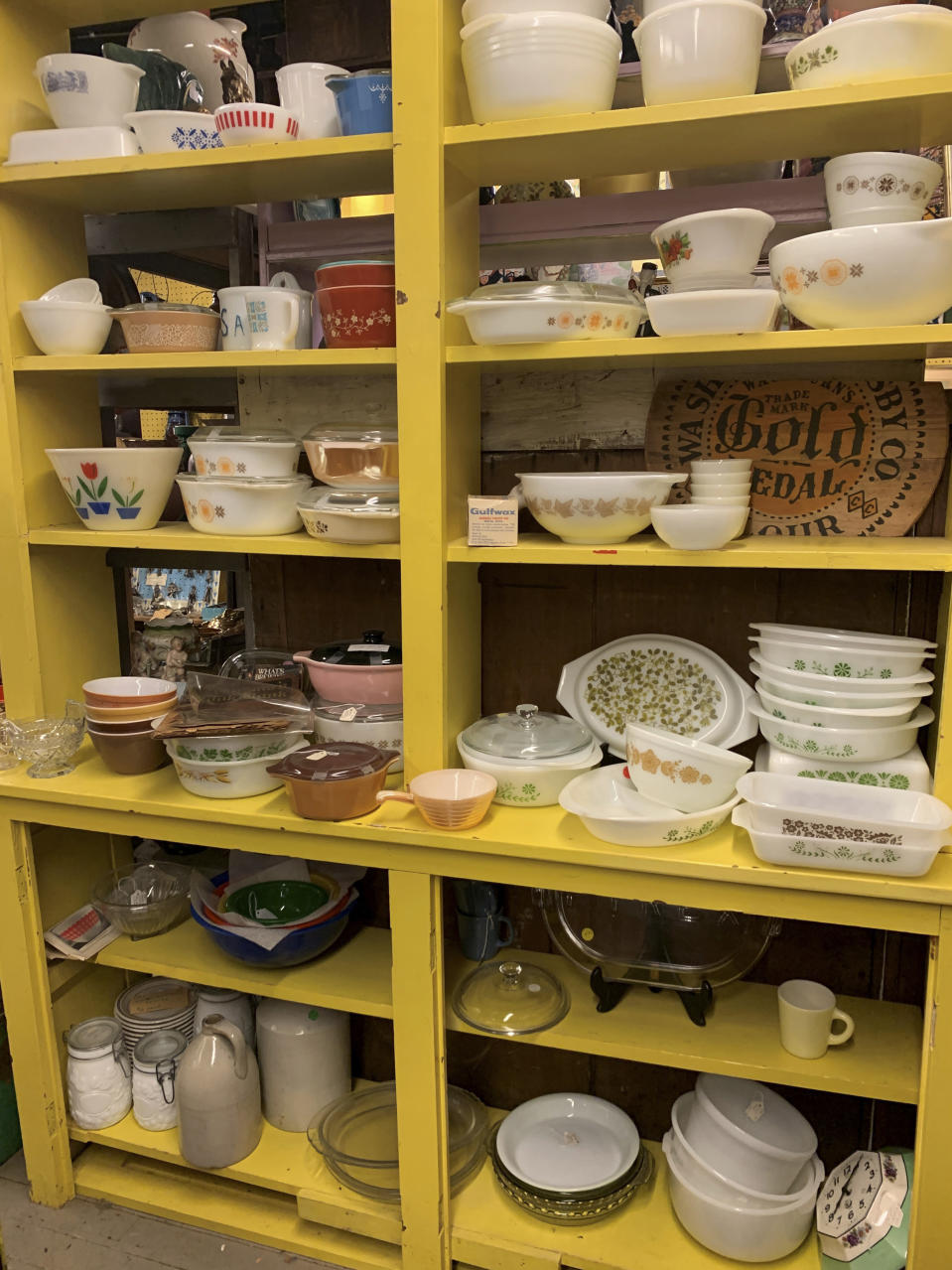 """This image provided by Tracee Herbaugh shows one area of vintage dishes for sale at """"Downstairs at Felton Antiques"""" in Waltham, Massachusetts. Some collectors buy vintage dishware to try to re-sell it at a profit, while others are in it for nostalgia. """"It reminds them of their mothers, aunts, grandmothers,"""" said Hope Chudy, owner of Downstairs at Felton Antiques. (Tracee Herbaugh via AP)"""