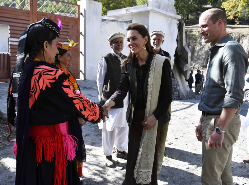 The Duke and Duchess of Cambridge speak with flood victims during a visit to Bumburet village in the Chitral District of Khyber-Pakhunkwa Province in Pakistan on the third day of the royal visit. Source: Neil Hall/PA Wire