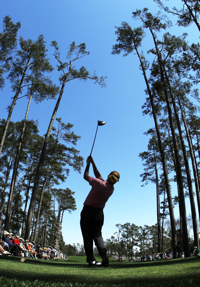 Miguel Angel Jimenez, of Spain, tees off on the 17th hole during the first round of the Masters golf tournament Thursday, April 10, 2014, in Augusta, Ga. (AP Photo/Matt Slocum)