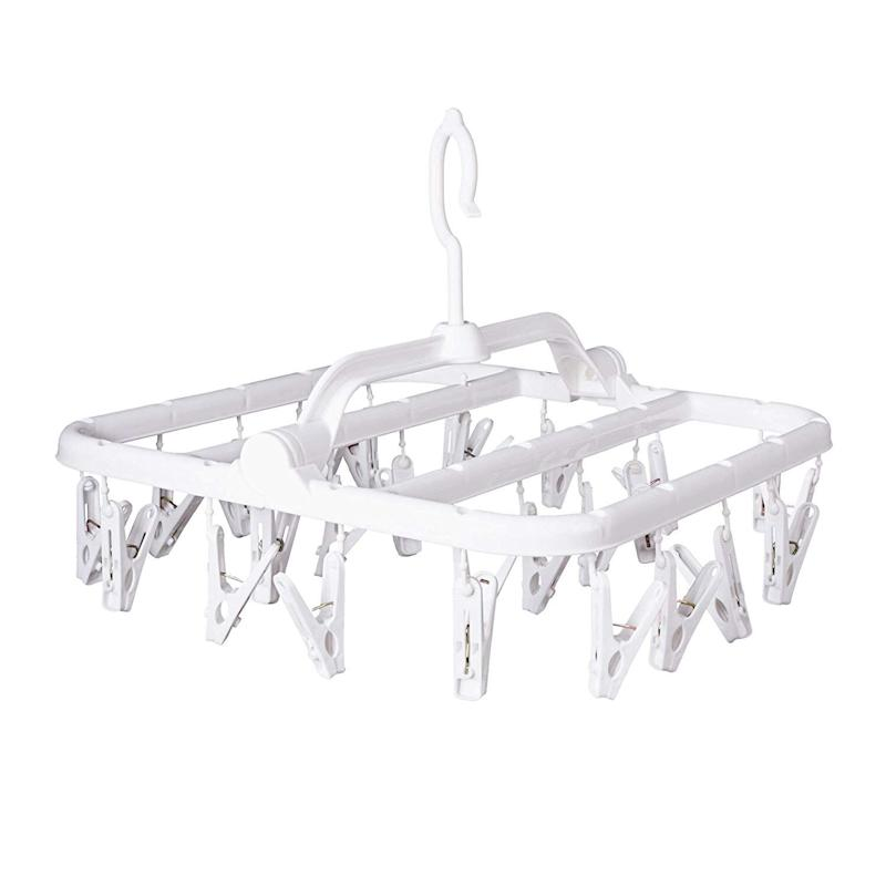 """Whether you're super tight on space or only need to air-dry a few things every time you do laundry, this clip-and-dry hanger is a practical solution. <strong><a href=""""https://www.amazon.com/Foldable-Underwear-Clothespins-Collapsible-Portable/dp/B07PP2CBTD?tag=thehuffingtop-20"""" target=""""_blank"""" rel=""""noopener noreferrer"""">Get it on Amazon, $9</a></strong>."""