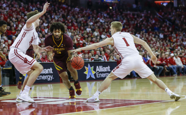 Minnesota's Jordan Murphy (3) drives between Wisconsin's Nate Reuvers (35) and Brevin Pritzl (1) during the first half of an NCAA college basketball game Thursday, Jan. 3, 2019, in Madison, Wis. (AP Photo/Andy Manis)