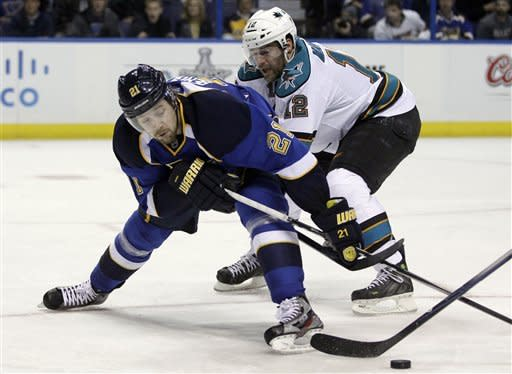 St. Louis Blues' Patrik Berglund, left, of Sweden, and San Jose Sharks' Patrick Marleau, right, chase after a loose puck during the second period in Game 5 of an NHL first-round playoff series hockey game on Saturday, April 21, 2012, in St. Louis. (AP Photo/Jeff Roberson)
