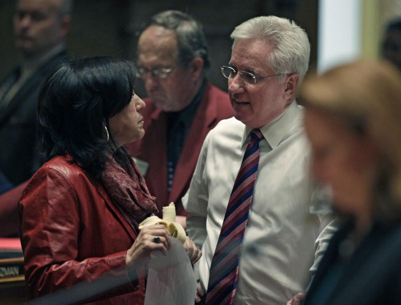 Colorado Senate President John Morse, right, speaks with fellow senator Angela Giron, left, at the State Capitol, in Denver, Friday March 8, 2013.  Colorado Senate Democrats advanced an expansion of background checks on firearm purchases as part of a package of bills responding to the shootings in Aurora and Connecticut.  The proposal would require background checks where they currently don't exist, such as purchases online and private sales and transfers. The bill got initial approval in the Senate on an unrecorded vote on Friday.  (AP Photo/Brennan Linsley)