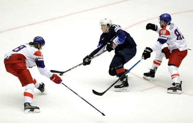 Ice Hockey - 2018 IIHF World Championships - Quarterfinals - USA v Czech Republic - Jyske Bank Boxen - Herning, Denmark - May 17, 2018 - Johnny Gaudreau of the U.S. in action with Libor Sulak and David Pastrnak of the Czech Republic. REUTERS/David W Cerny