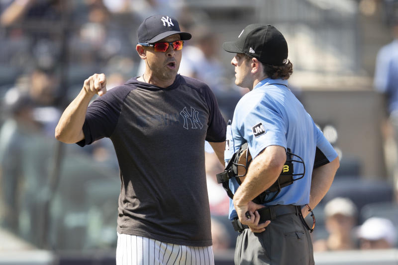 New York Yankees manager Aaron Boone, outfielder Brett Gardner and pitcher CC Sabathia were all ejected during Saturday's game against the Cleveland Indians. (AP Photo/Mary Altaffer)