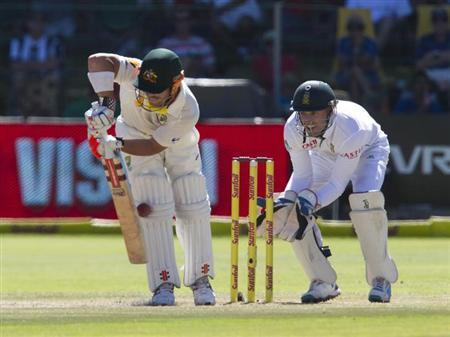 Australia's Dave Warner is trapped leg before wicket as South Africa's AB de Villiers looks on during the fourth day of the second cricket test match in Port Elizabeth, February 23, 2014. REUTERS/Rogan Ward