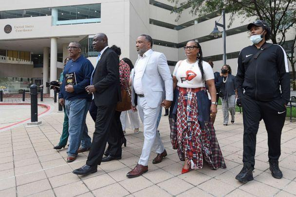 PHOTO: Attorney Ben Crump, second from left, walks with Ron Lacks, left, Alfred Lacks Carter, third from left, both grandsons of Henrietta Lacks, and other descendants, outside the federal courthouse in Baltimore, Oct. 4, 2021. (Steve Ruark/AP)