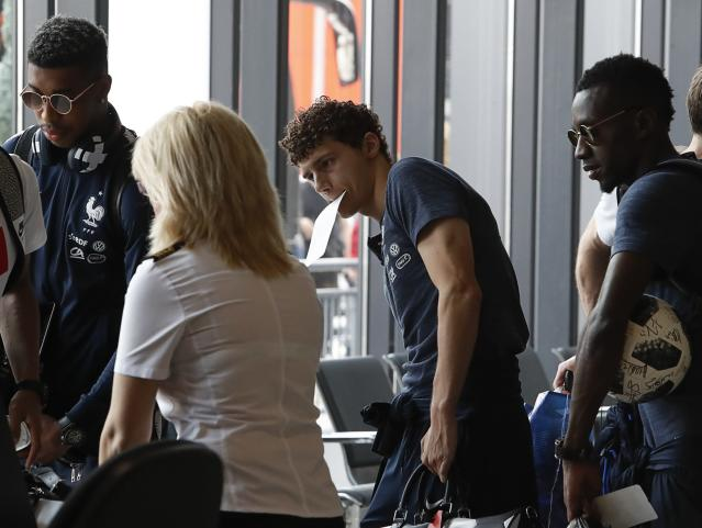 Soccer Football - World Cup - France Departure - Sheremetyevo International Airport, Moscow Region, Russia - July 16, 2018. Benjamin Pavard and his teammates queue while passing through a security checkpoint before the departure. REUTERS/Sergei Karpukhin