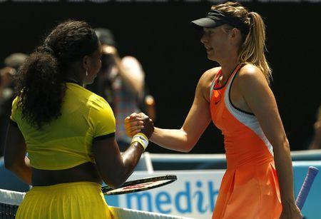 Russia's Maria Sharapova (R) reacts as she shakes hands with Serena Williams of the U.S. after Williams won their quarter-final match at the Australian Open tennis tournament at Melbourne Park, Australia, January 26, 2016. REUTERS/Thomas Peter/Files
