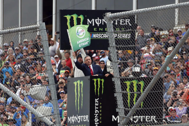 Pastor of First Baptist Church Dallas Dr. Robert Jeffress waves the green flag for the start of a NASCAR Cup Series auto race at Talladega Superspeedway, Sunday, Oct. 13, 2019, in Talladega, Ala. (AP Photo/Butch Dill)