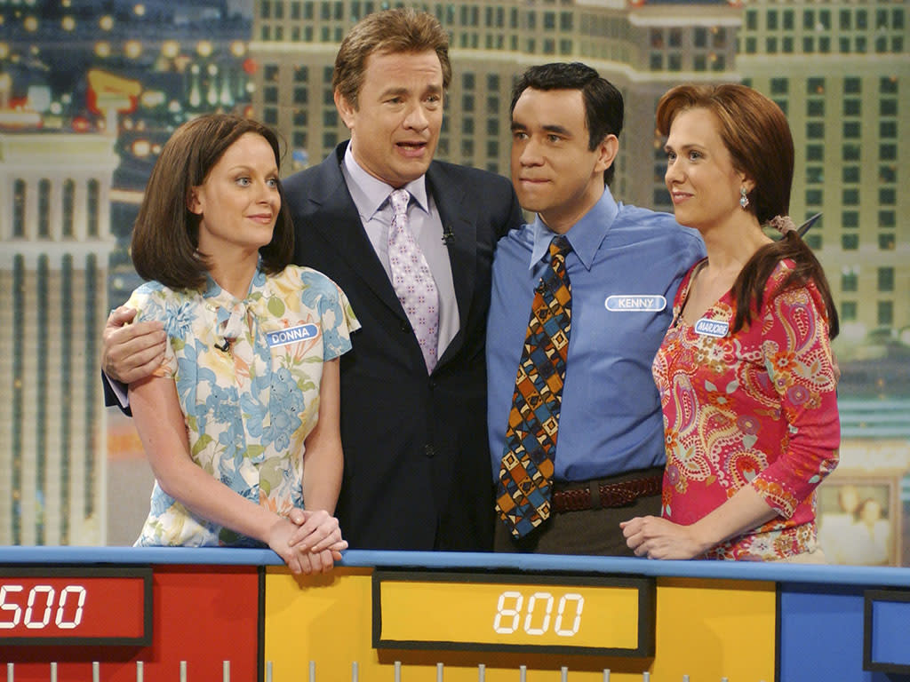 "SATURDAY NIGHT LIVE -- Episode 17 -- Aired 05/06/2006 -- Pictured: (l-r) Amy Poehler as Donna, Tom Hanks as Pat Sajak, Fred Armisen as Kenny, Kristen Wiig as Marjorie during ""Wheel of Fortune"" skit on May 6, 2006  (Photo by Dana Edelson/NBC/NBCU Photo Bank via Getty Images)"