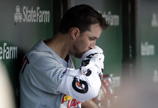 St. Louis Cardinals starting pitcher Adam Wainwright wipes his face in the dugout during the third inning of a baseball game against the Chicago Cubs, Sunday, May 5, 2019, in Chicago. (AP Photo/Nam Y. Huh)