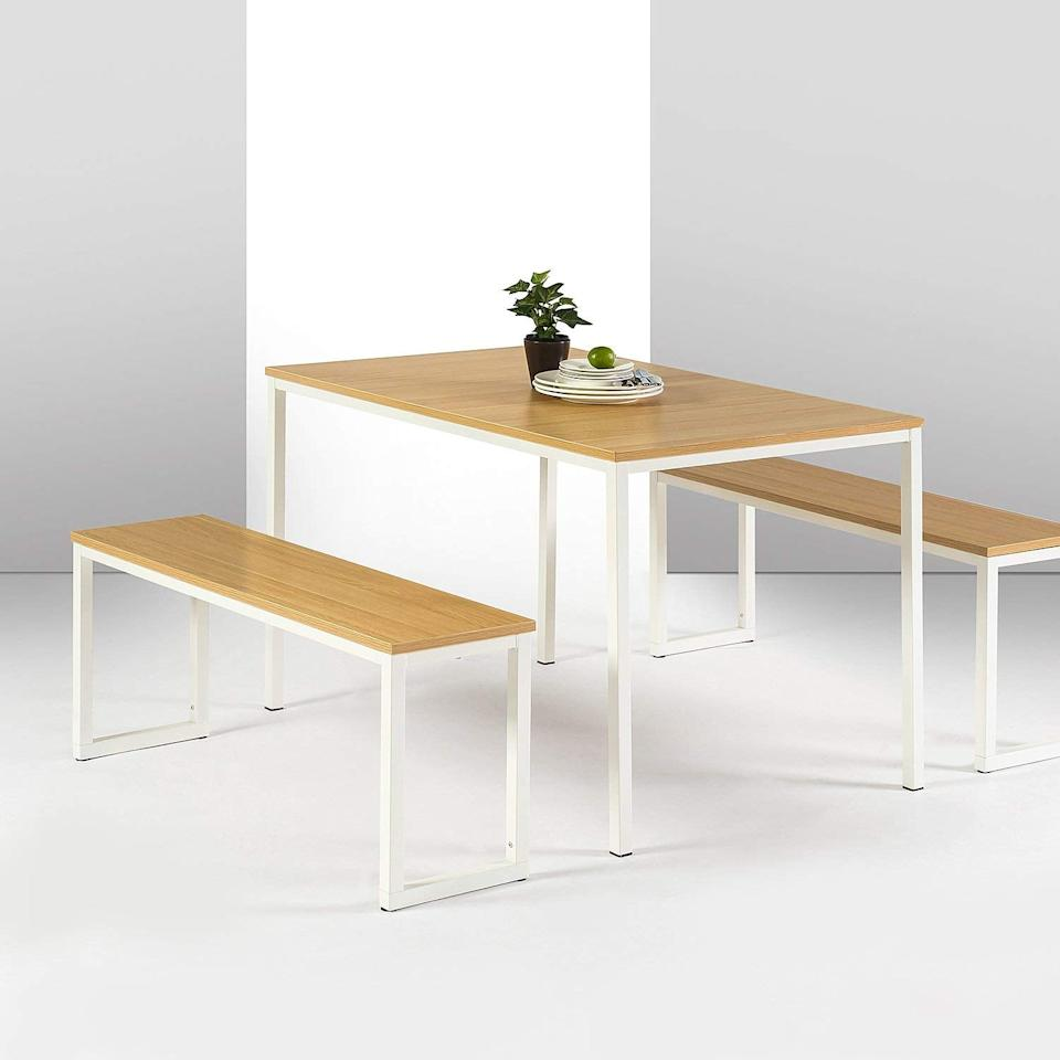 """<p>This <a href=""""https://www.popsugar.com/buy/Zinus-Louis-Modern-Studio-Collection-Soho-Dining-Table-517044?p_name=Zinus%20Louis%20Modern%20Studio%20Collection%20Soho%20Dining%20Table&retailer=amazon.com&pid=517044&price=180&evar1=casa%3Aus&evar9=45791994&evar98=https%3A%2F%2Fwww.popsugar.com%2Fhome%2Fphoto-gallery%2F45791994%2Fimage%2F46895967%2FZinus-Louis-Modern-Studio-Collection-Soho-Dining-Table&list1=shopping%2Camazon%2Chome%20decor%2Cfurniture&prop13=mobile&pdata=1"""" rel=""""nofollow"""" data-shoppable-link=""""1"""" target=""""_blank"""" class=""""ga-track"""" data-ga-category=""""Related"""" data-ga-label=""""https://www.amazon.com/Zinus-Modern-Studio-Collection-Benches/dp/B075FCVZ9J/ref=sr_1_14?crid=3W2RGDGUZMX70&amp;keywords=white+modern+dining+table&amp;qid=1573675038&amp;sprefix=white+modern+dining+%2Caps%2C203&amp;sr=8-14"""" data-ga-action=""""In-Line Links"""">Zinus Louis Modern Studio Collection Soho Dining Table</a> ($180, originally $202) comes with two benches and is a great space-saving choice.</p>"""