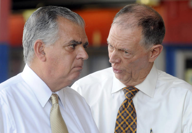 U.S. Transportation Secretary Ray LaHood, left, talks to FAA Administrator Randy Babbitt during a news conference to discuss the interruption of federal funding for airport construction projects and contractors at LaGuardia Airport in New York, Monday, August 1, 2011.The FAA's operating authority expired at midnight Friday, forcing a partial shutdown of the agency. Dozens of airport construction projects across the country have been put on hold and thousands of federal employees were out of work.   (AP Photo/Henny Ray Abrams)