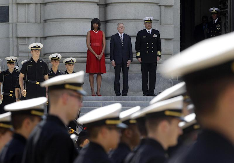 First lady Michelle Obama, top left, views a formation of midshipmen at the U.S. Naval Academy in Annapolis, Md., Wednesday, April 17, 2013, with Navy Secretary Ray Mabus, center, and Naval Academy Commandant Robert Clark. Mrs. Obama visited with midshipmen who will be affected by Maryland's new Veterans Full Employment Act of 2013. The bill, passed by the Maryland General Assembly, creates an expedited licensing procedure for veterans and military spouses who hold professional licenses in other states. It also requires Maryland's public colleges and universities to develop policies to award academic credit for relevant military training and education. (AP Photo/Patrick Semansky)