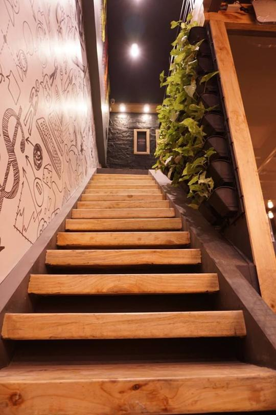 Stairway to heaven-  A vertical live wall on the right & motivational flexes on the left.