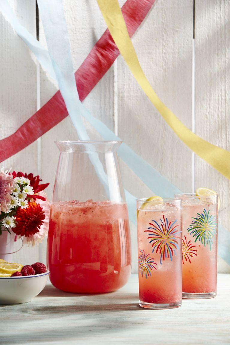 """<p>Our ideal 4th of July is to sit back, relax, and sip on this pretty pink drink all day long.</p><p><strong><a href=""""https://www.countryliving.com/food-drinks/a28196115/raspberry-and-lemon-rose-sparkler-recipe/"""" rel=""""nofollow noopener"""" target=""""_blank"""" data-ylk=""""slk:Get the recipe"""" class=""""link rapid-noclick-resp"""">Get the recipe</a>.</strong> </p>"""