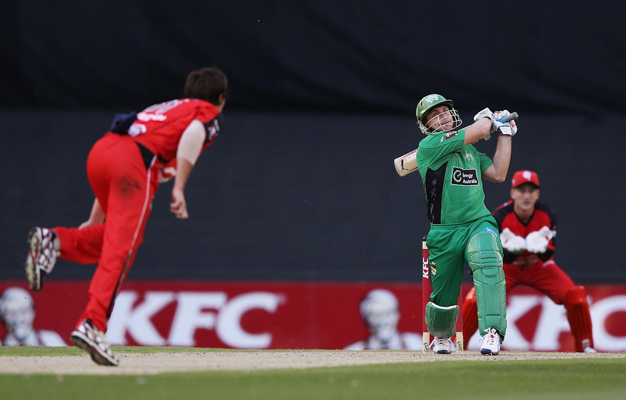 MELBOURNE, AUSTRALIA - DECEMBER 07:  Brad Hodge of the Stars hits the ball against Will Sheridan of The Renegades during the Big Bash League match between the Melbourne Renegades and the Melbourne Stars at Etihad Stadium on December 7, 2012 in Melbourne, Australia.  (Photo by Michael Dodge/Getty Images)
