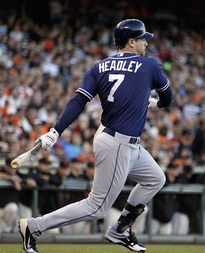 San Diego Padres' Chase Headley swings for an RBI ground out off San Francisco Giants' Madison Bumgarner in the first inning of a baseball game, Saturday, Sept 22, 2012, in San Francisco. (AP Photo/Ben Margot)