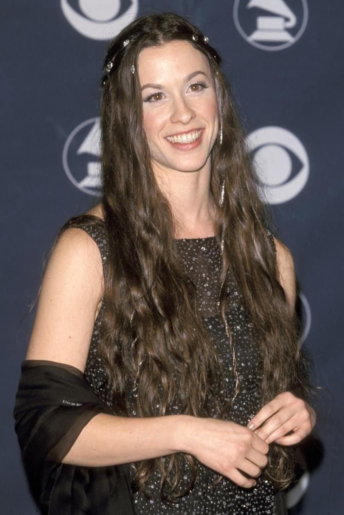 """<h3>Alanis Morissette, 1999</h3><br>Alanis Morissette was ahead of the trends when she wore these <a href=""""https://www.refinery29.com/en-us/2018/12/219657/fancy-hair-clips"""" rel=""""nofollow noopener"""" target=""""_blank"""" data-ylk=""""slk:elegant hair clips"""" class=""""link rapid-noclick-resp"""">elegant hair clips</a> in 1999.<span class=""""copyright"""">Photo: Ron Galella Ltd./Ron Galella Collection/Getty Images.</span>"""