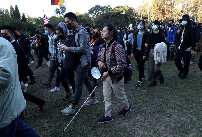 Joy Luk, a blind lawyer, attends Hong Kong protests
