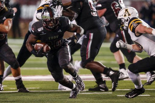 Troy running back DK Billingsley (20) carries the ball during the second half of the team's NCAA college football game against Appalachian State on Friday, Nov. 29, 2019, in Troy, Ala. (AP Photo/Butch Dill)