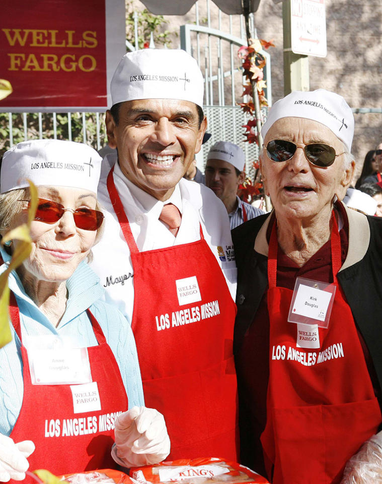 "Hollywood legend Kirk Douglas took time out for a photo op with the mayor of Los Angeles, Antonio Villaraigosa. The 95-year-old actor and his wife Anne have been supporters of the Los Angeles Mission for years. "" It's a gratifying experience handing a hot meal to those who need it,"" once wrote in a piece for <em>Los Angeles Confidential</em>. ""As I look at this wonderful organization, the lives they have touched  and changed by caring enough to give to those less fortunate, I can't  help but remember the words my mother said to me so many years ago: 'Help someone worse off than you are.'"" (11/21/2012)"