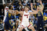 Miami Heat forward Meyers Leonard (0) defends Indiana Pacers forward T.J. Warren (1) during the first half of an NBA basketball game in Indianapolis, Wednesday, Jan. 8, 2020. (AP Photo/AJ Mast)