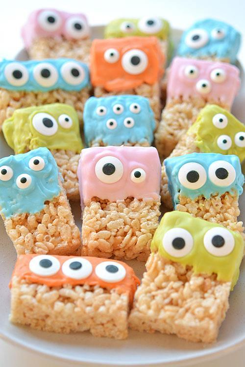 """<p><a href=""""http://onelittleproject.com/rice-krispie-treat-monsters/"""" rel=""""nofollow noopener"""" target=""""_blank"""" data-ylk=""""slk:These Rice Krispie treat monsters"""" class=""""link rapid-noclick-resp"""">These Rice Krispie treat monsters</a> are another simple DIY that involve just a few ingredients you probably already have in your pantry. Rice Krispie treats are transformed into a creepy dessert by dipping them into candy melts and finishing them off with some crazy candy eyes. We love that you can use different-sized and -shaped eyes to make an assortment of characters.</p>"""