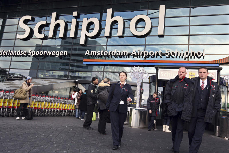FILE This Saturday Dec. 26, 2009 file photo shows security workers leave Schiphol airport in Amsterdam, Netherlands. Police at Amsterdam's Schiphol Airport have opened a criminal investigation into how needles got into turkey sandwiches served to passengers on Delta Air Lines flights from Amsterdam to the United States, a spokesman said Tuesday July 17, 2012. The FBI also is investigating the incidents. Delta said what appear to be sewing needles were found in five sandwiches on Sunday July 15, 2012. One passenger on a flight to Minneapolis was injured. The other needles were on two flights to Atlanta and one to Seattle. (AP Photo/Evert Elzinga)