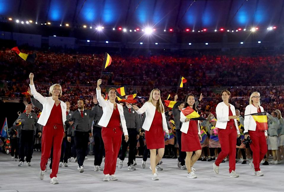 <p>Belgium has produced some highly influential fashion designers in the past 30 years (think Diane von Furstenberg and Dries van Noten). So in showcasing its Opening Ceremony outfits for the world to see, the pressure was on. The result was a superchic pseudo-bomber jacket with dark pants — minimalist meets athleisure.</p><p><i>(Photo: Getty Images)</i><br></p>