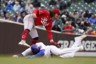 Cincinnati Reds' Jonathan India catches Chicago Cubs' Kris Bryant trying to steal second off a throw from catcher Tucker Barnhart during the sixth inning of a baseball game Friday, May 28, 2021, in Chicago. (AP Photo/Charles Rex Arbogast)