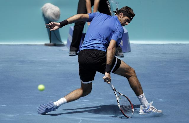 Juan Martin del Potro from Argentina returns a ball to Alexandr Dolgopolov from Ukraine during a Madrid Open tennis tournament match in Madrid, Spain, Friday, May 11, 2012. (AP Photo/Alberto Di Lolli)