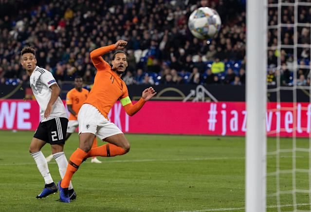 "<a class=""link rapid-noclick-resp"" href=""/soccer/players/380942/"" data-ylk=""slk:Virgil Van Dijk"">Virgil Van Dijk</a> scored the equalizer, but the celebration had to wait. (Photo by Boris Streubel/Getty Images)"
