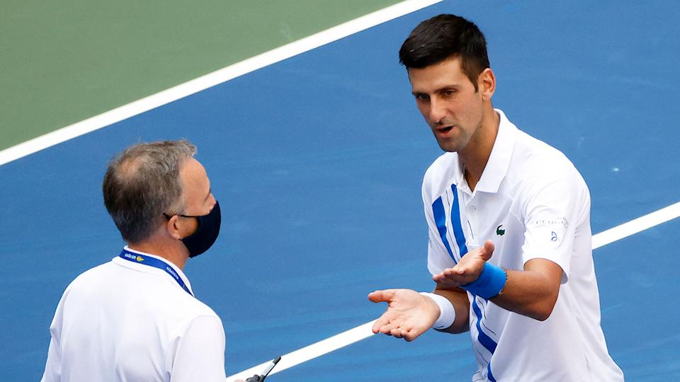 Pictured here, Novak Djokovic pleads his case with a US Open official after his fourth round controversy.