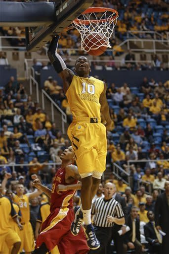 West Virginia's Eron Harris (10) dunks over Iowa State's Will Clyburn in the second half of an NCAA college basketball game at WVU Coliseum in Morgantown, W.Va., on Saturday, March 9, 2013. Iowa State won 83-74. (AP Photo/David Smith)