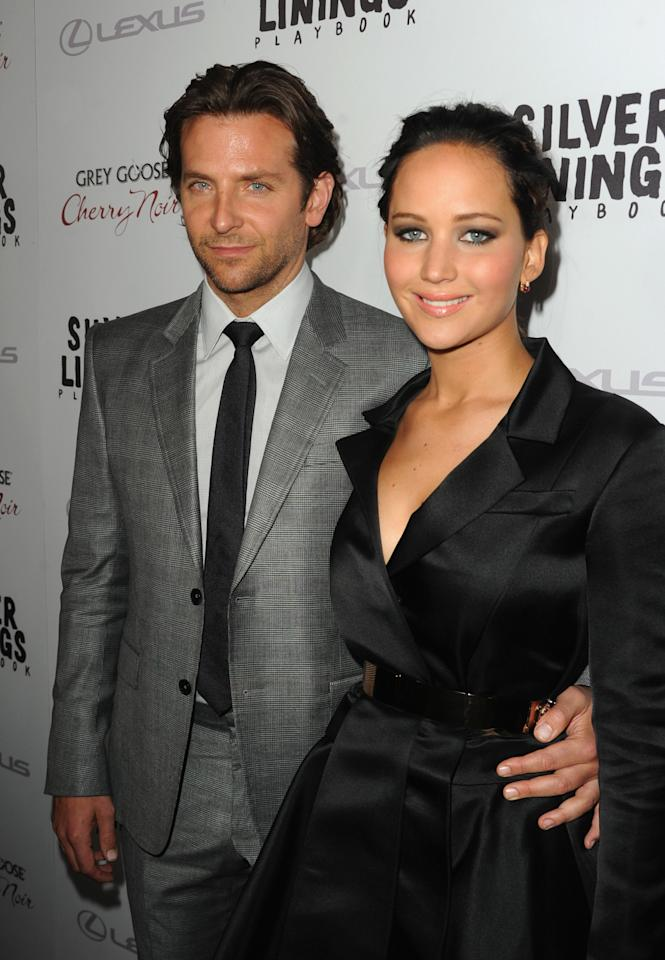 "BEVERLY HILLS, CA - NOVEMBER 19:  Actors Bradley Cooper and Jennifer Lawrence attend a screening of The Weinstein Company's ""Silver Linings Playbook"" at the Academy of Motion Picture Arts and Sciences on November 19, 2012 in Beverly Hills, California.  (Photo by Kevin Winter/Getty Images)"