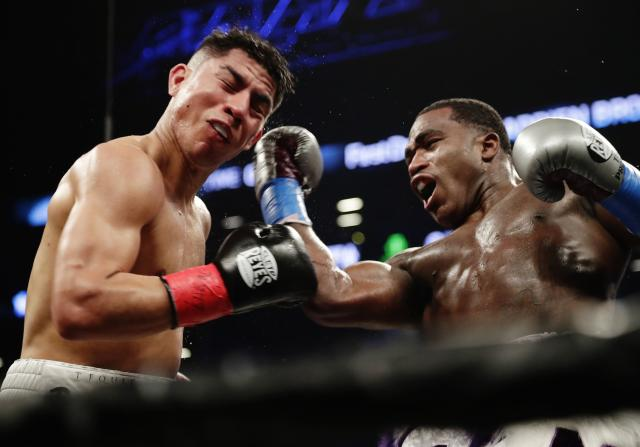 Adrien Broner, right, punches Jessie Vargas during the fourth round of a welterweight boxing match Saturday, April 21, 2018, in New York. (AP Photo/Frank Franklin II)