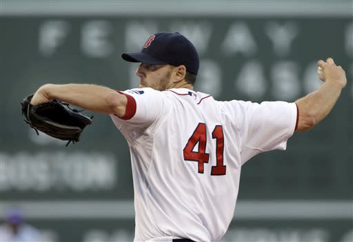 Boston Red Sox starting pitcher John Lackey delivers to the San Diego Padres during the first inning of an interleague baseball game at Fenway Park in Boston, Tuesday, July 2, 2013. (AP Photo/Elise Amendola)