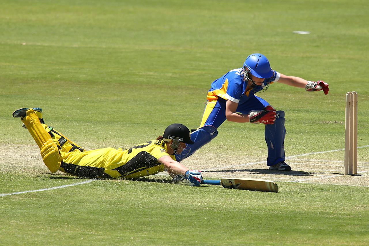 PERTH, AUSTRALIA - OCTOBER 13:  Jenny Wallace of the Fury dives to avoid being run out during the WT20 match between the Western Australia Fury and the ACT Meteors at the WACA on October 13, 2013 in Perth, Australia.  (Photo by Paul Kane/Getty Images)